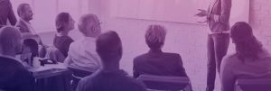people watching presentation with purple overlay