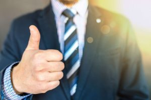 Man in suit giving a Thumbs Up