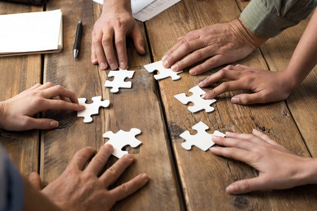 People working together on a puzzle