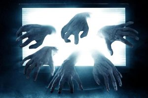 Ghostly hands reach out of laptop screen, signaling AV issues.