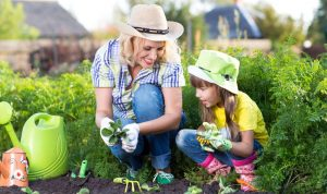 Woman and daughter are gardening, which is symbolically similar to growing your business.