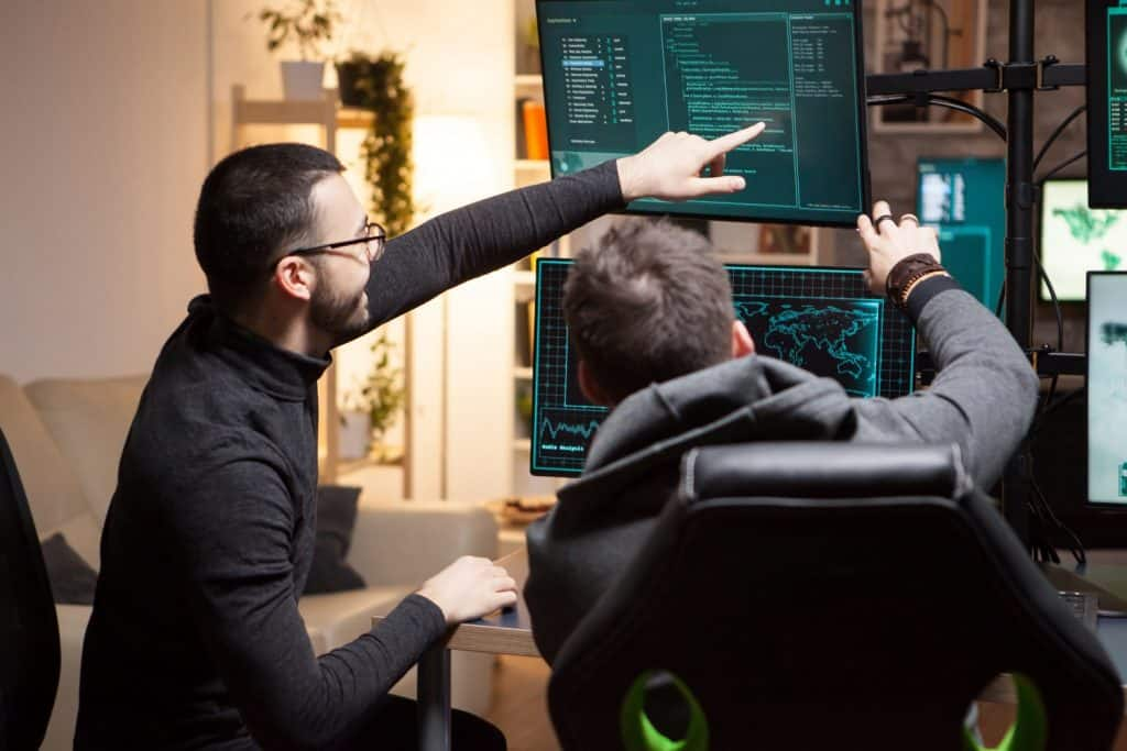Hackers pointing at screen